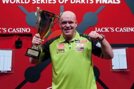 Michael van Gerwen lifting the World Series of Darts Finals trophy in 2019