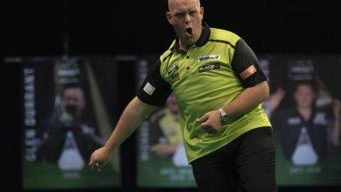 Van Gerwen thrashes Van den Bergh to go second in table